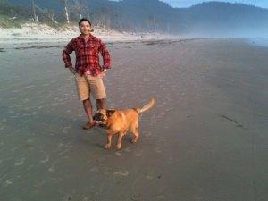 Anthony Alvarado smokes a pipe on the beach