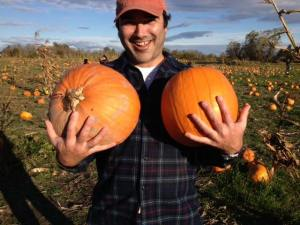 Anthony Alvarado picks pumpkins